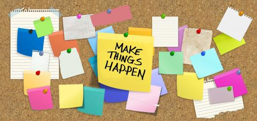 Image of cork board with multiple coloured sticky notes and a large yellow note in the centre with 'Make Things Happen' written in black ink.